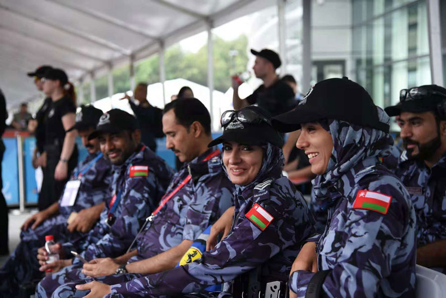 Players from Oman watching the competition